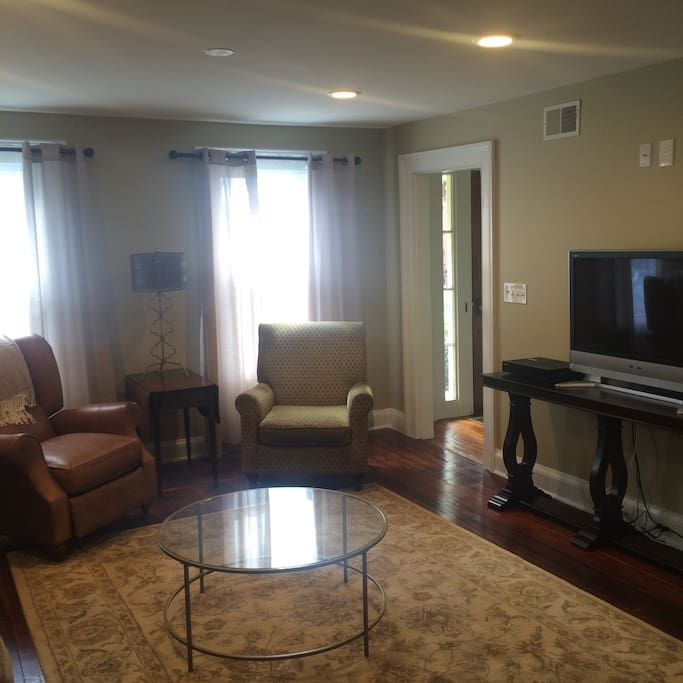 Bright and inviting living room with flat screen TV and WiFi throughout the house