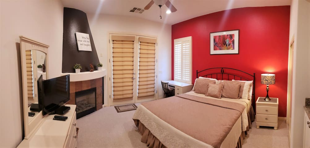 17. Guest Bedroom with private balcony. Includes fireplace, King bed, PC work area, microwave, kitchenette with mini fridge.