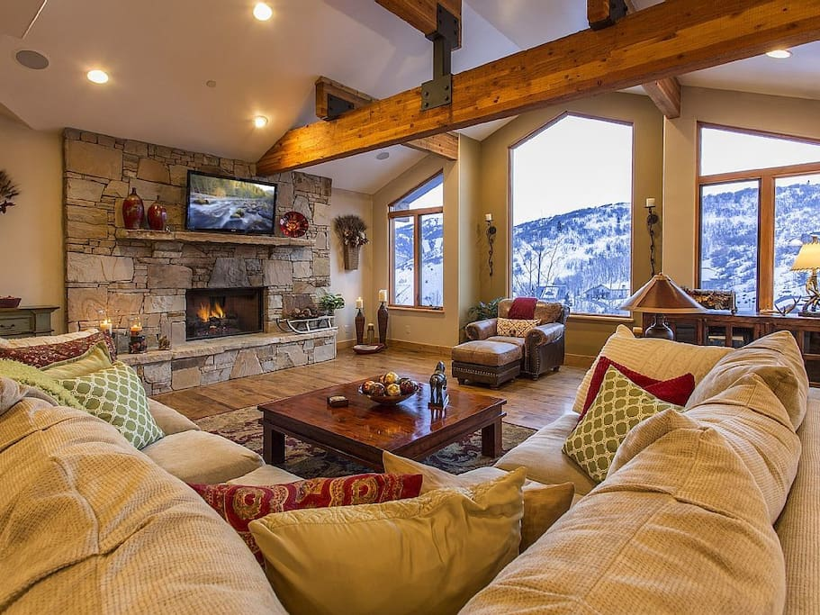 Elegant Great Room with Custom Fireplace and Flat Screen TV