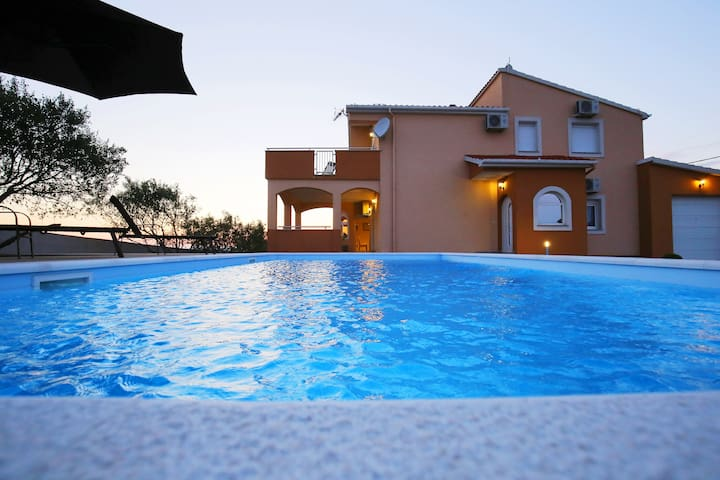 Villa Andrea with a panorama view & a heated pool
