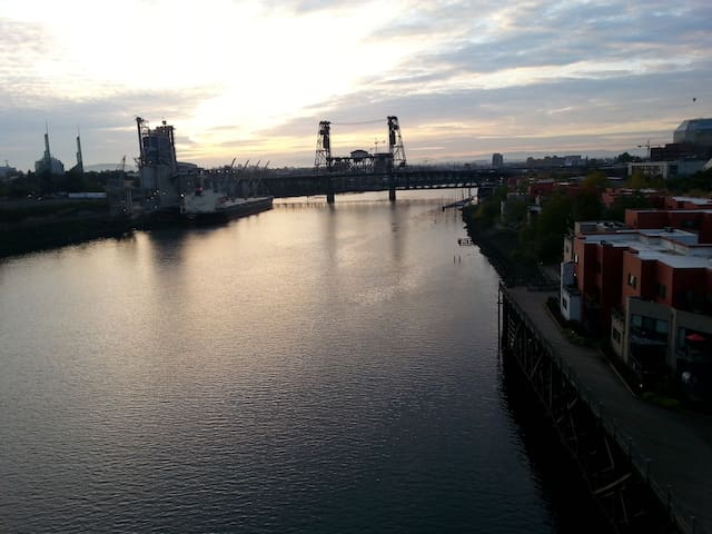 View of the Willamette River from the Broadway Bridge. Condo on the right.