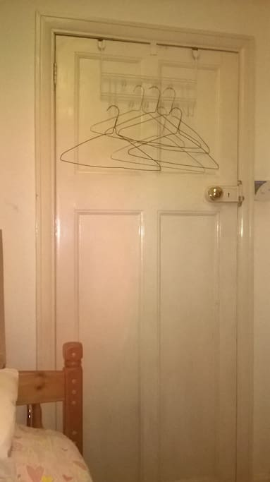 You can hang your clothes on the door.