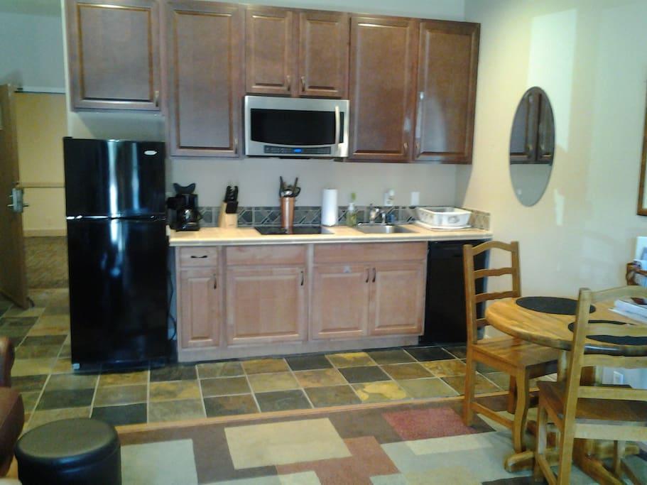 Plenty of storage and working area in kitchen.