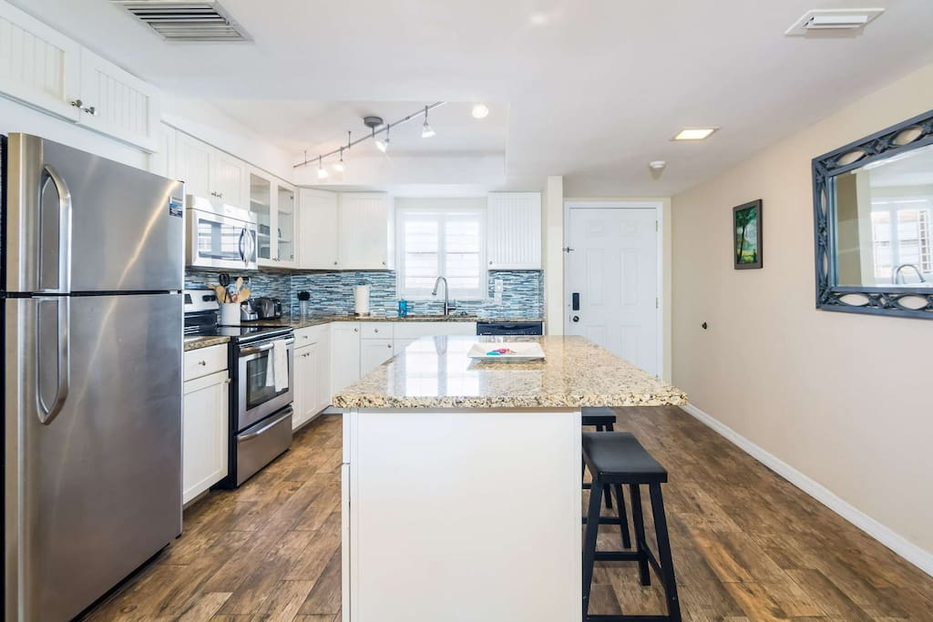 Fully equipped kitchen with all major stainless steel appliances and all items necessary to prepare and serve a meal.