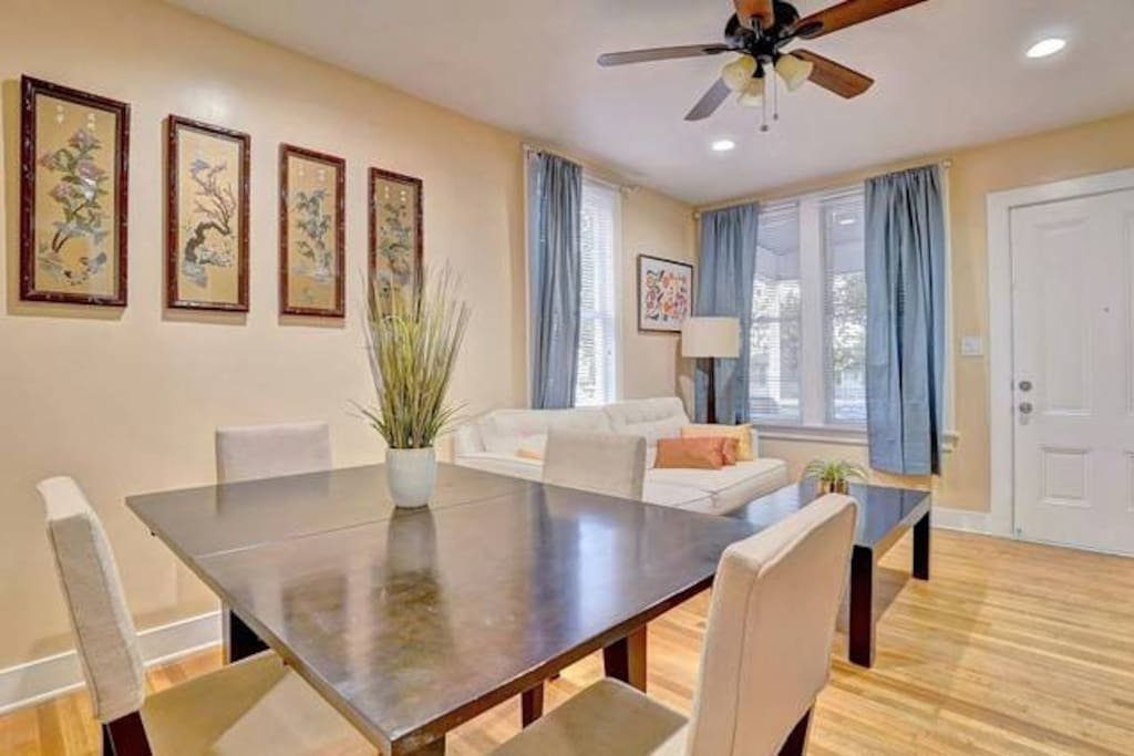 Living room and dining room with TV, entertainment center and high-speed fiber wifi internet.
