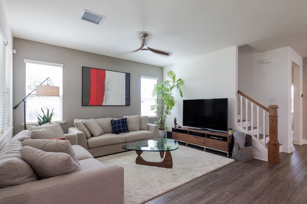 Living area with 65 inch flat screen television