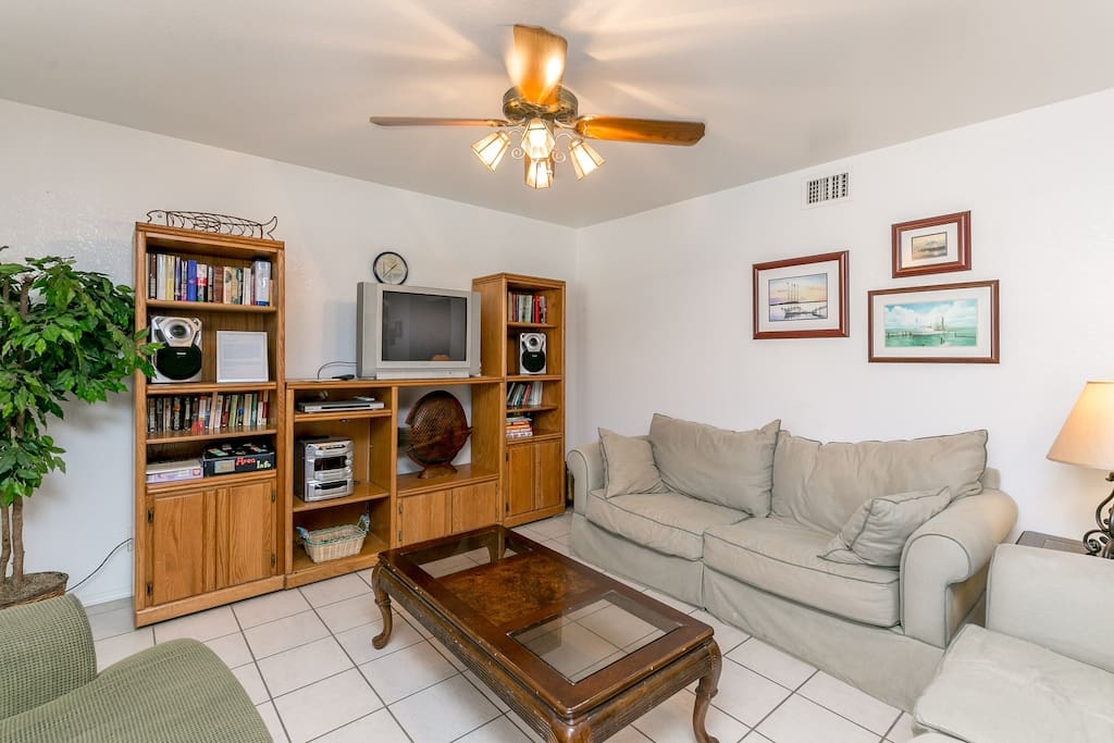 A comfortable place to relax: plenty of seating, entertainment unit, TV, stereo and coffee table
