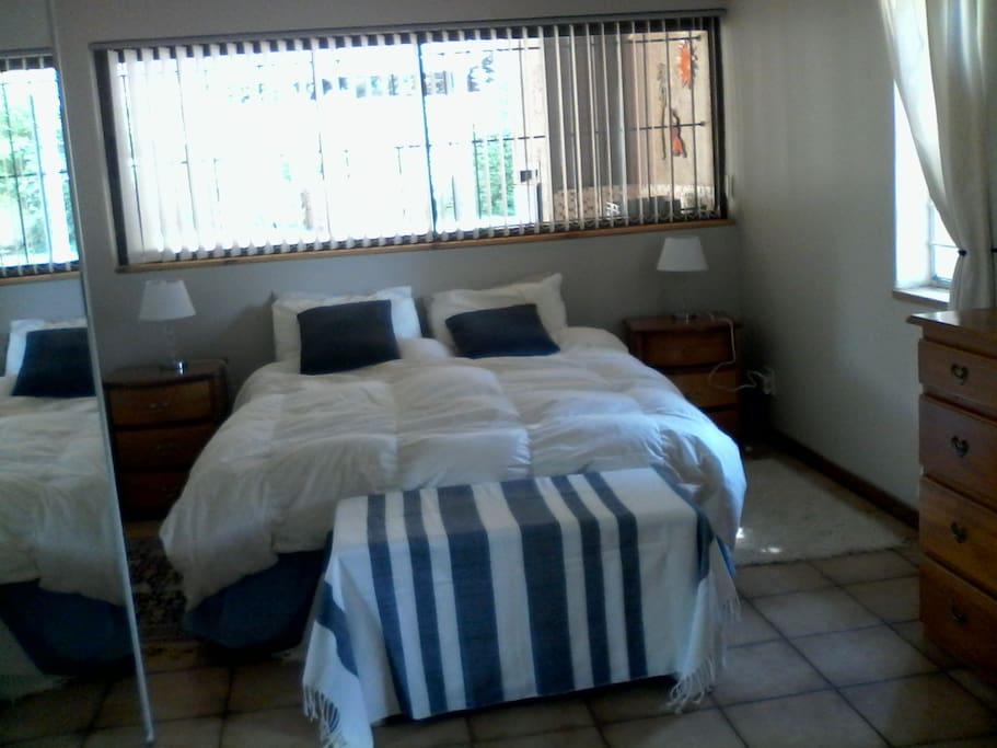 Spacious bedroom with King size extra length bed.