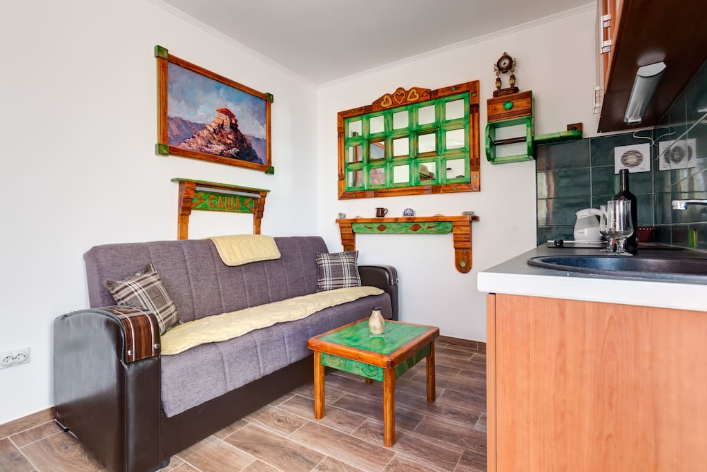 Living room has a comfortable bed, TV with cable TV, wardrobe, air conditioning and Wi Fi internet connection.