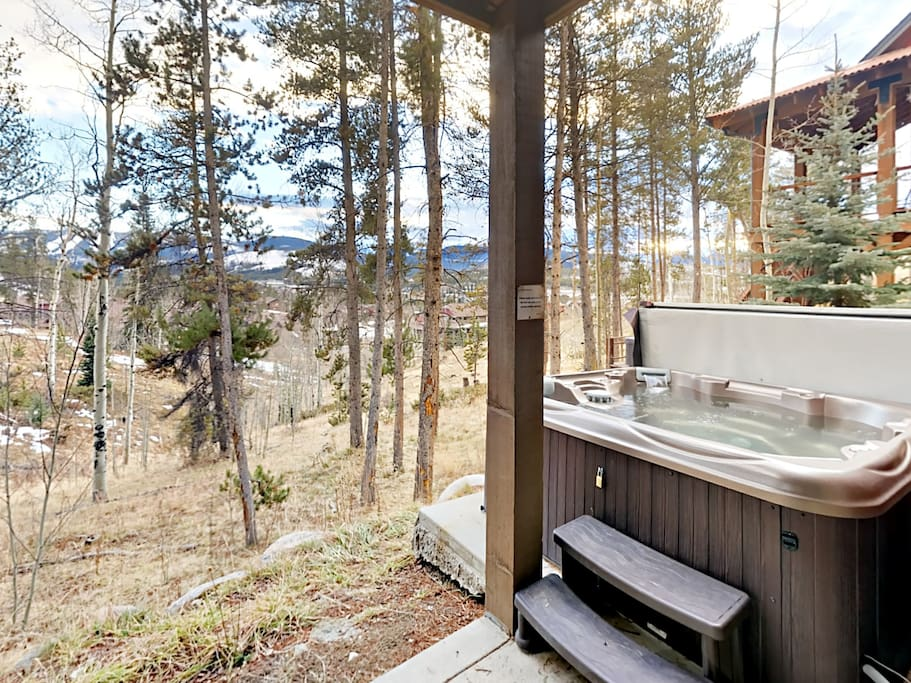 A private hot tub and mountain views on the backyard deck.