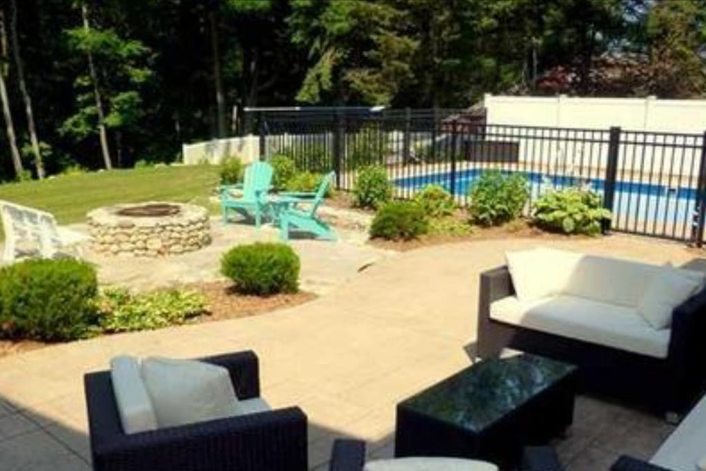 Amazing backyard with patio, in ground heated pool and fire pit.