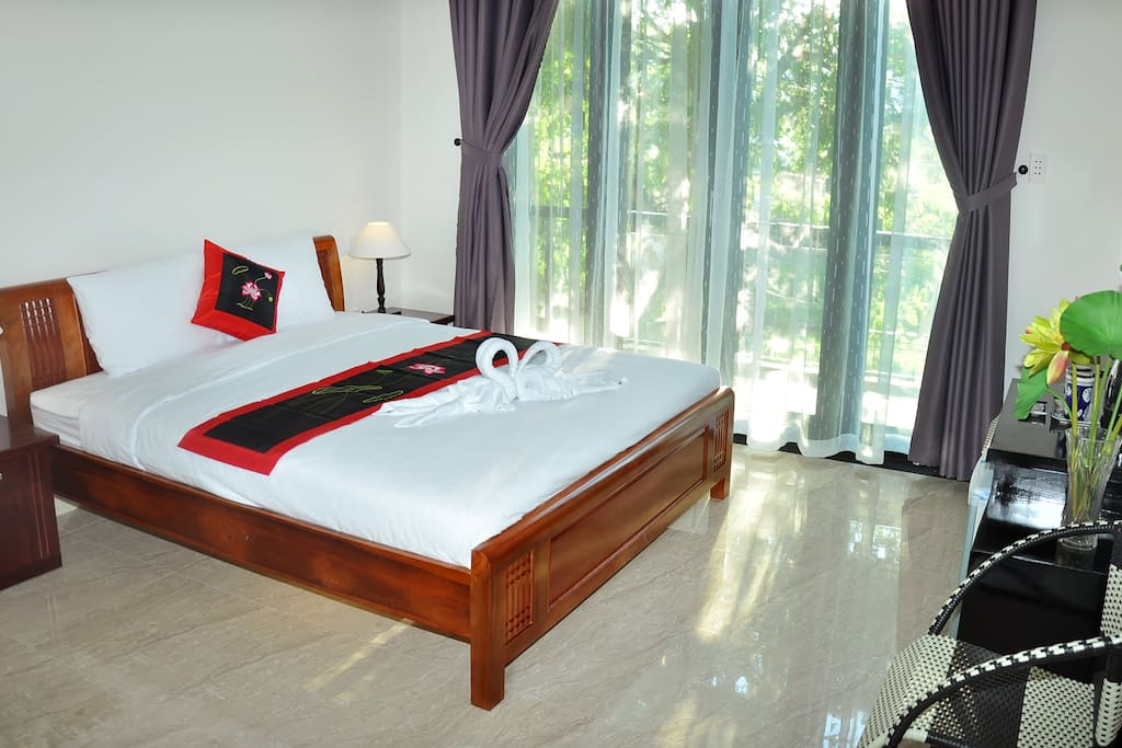 Spacious bedroom with one king size bed