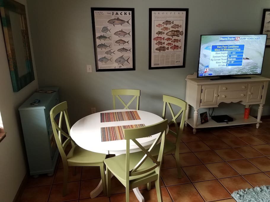 Casual dining for four in the main living area.