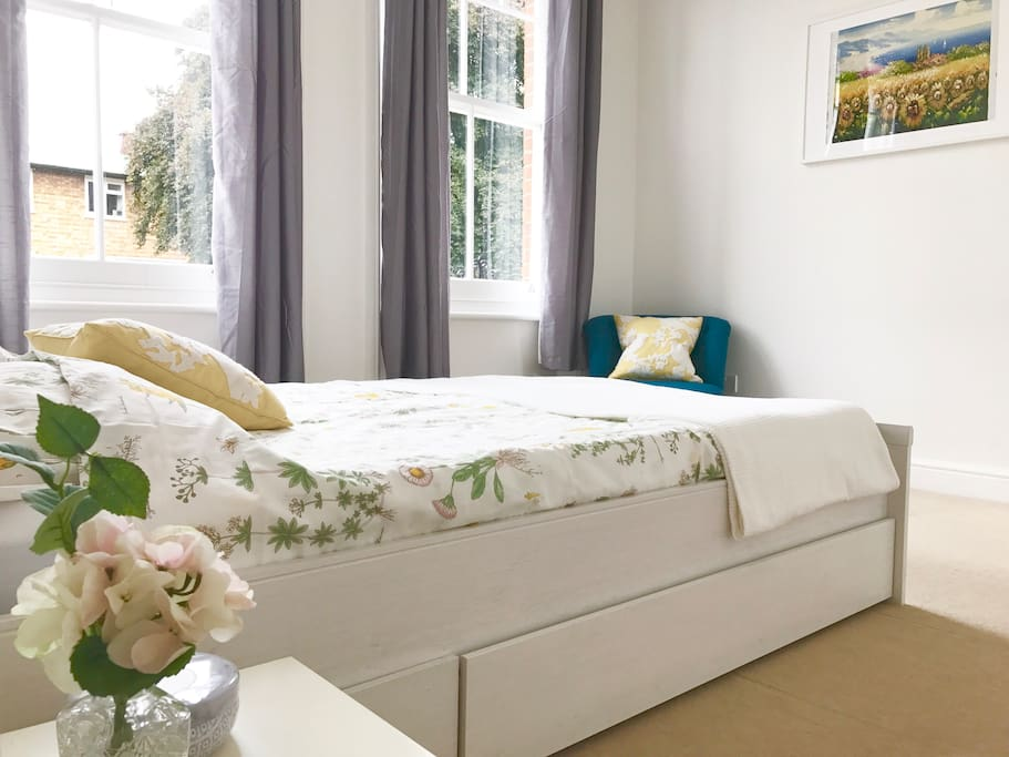 Large Bright Bedroom features queen bed with foam mattress and black-out curtains