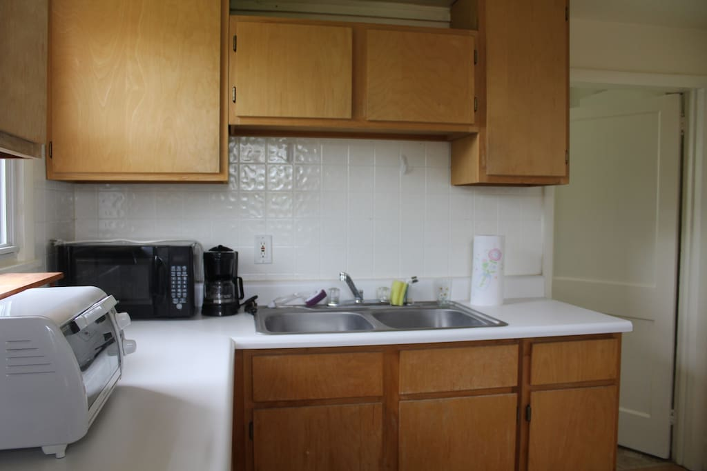 Kitchen cabinets have dishes, utensils and other necessities