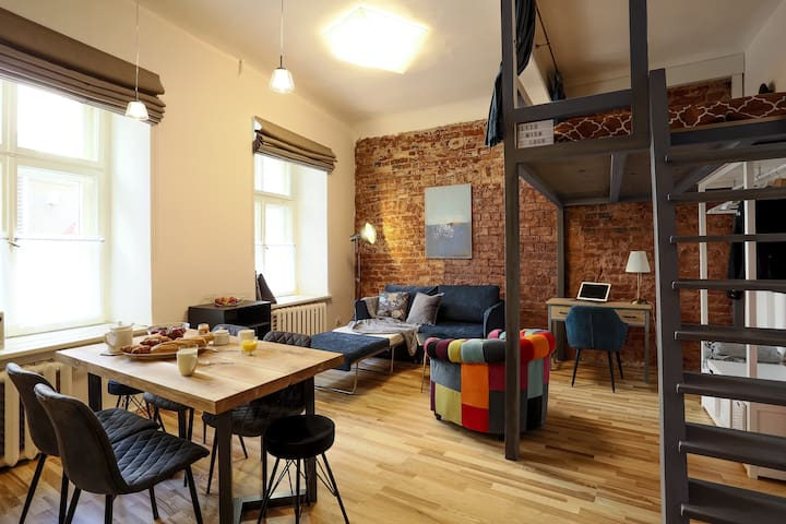 Old Riga stylish design studio with mezzanine