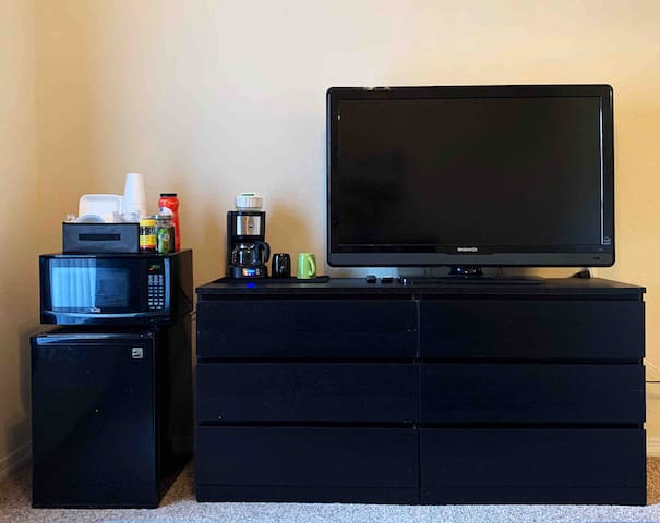 """The large empty dresser is provided for guests, as well as mini fridge, microwave and coffee station. The 50"""" TV has multiple streaming apps to enjoy your favorite shows and movies."""