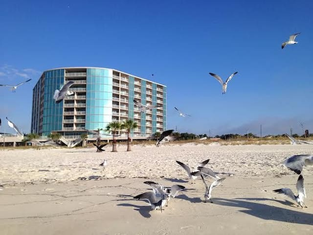 View of condo building from beach.