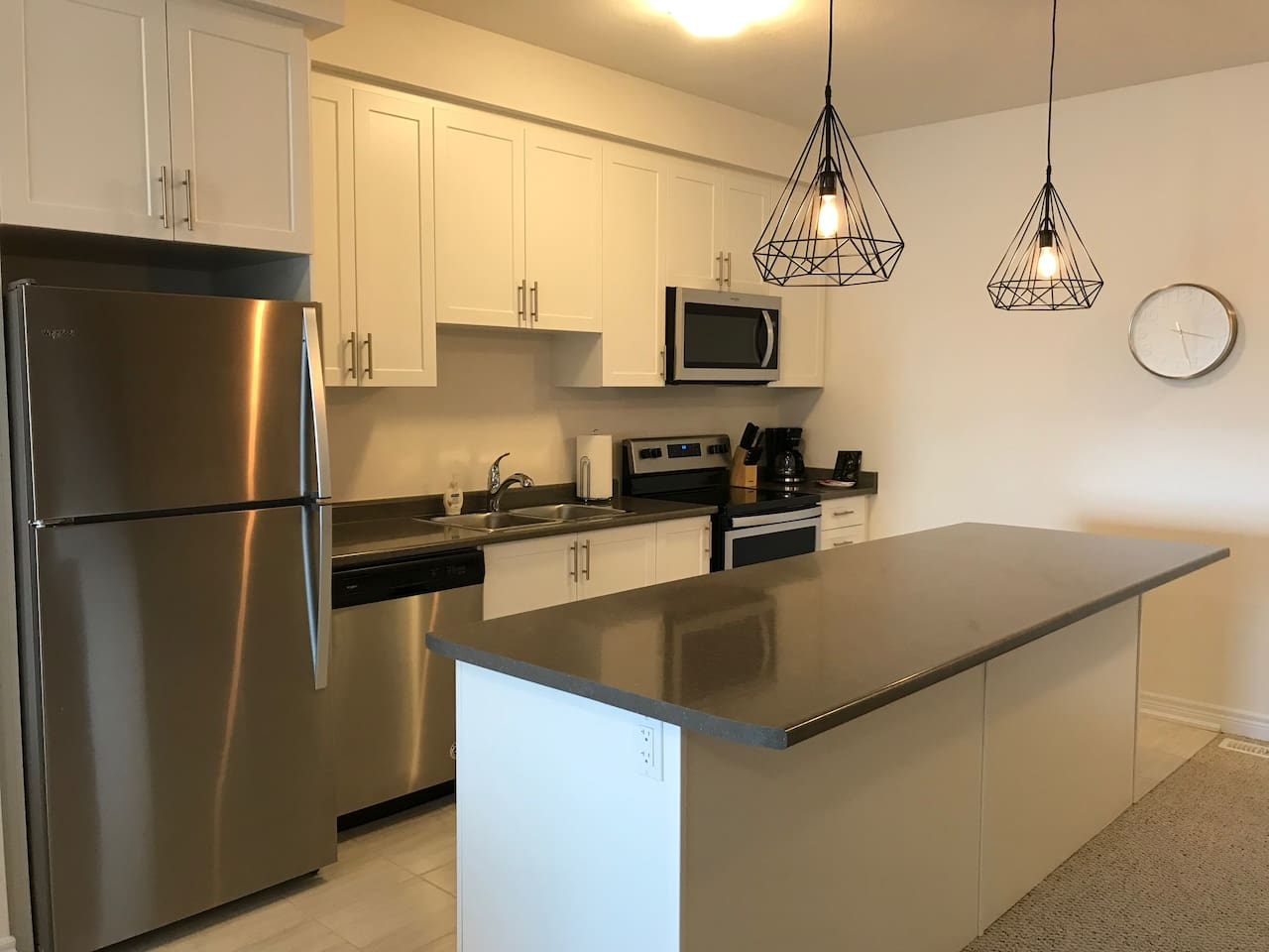 Fully equipped kitchen with breakfast bar that will seat four