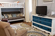The futon doubles as a couch and extra bed (futon mattress is full-size mattress). 2 easy chairs provide comfort for watching TV or playing the Wii! To the left of this photo is a Queen Murphy bed.