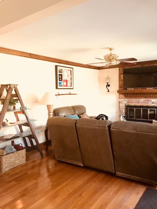 Family room with fireplace and big screen tv