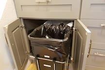 Slide-out trash/recycling bins