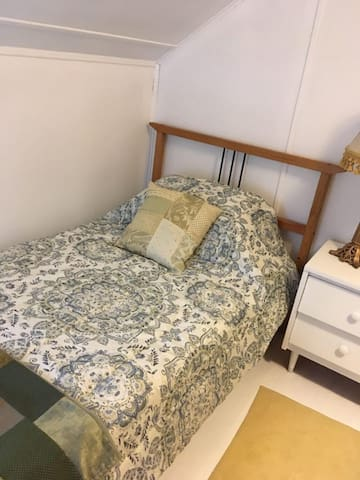 Comfy single bed in cozy bedroom