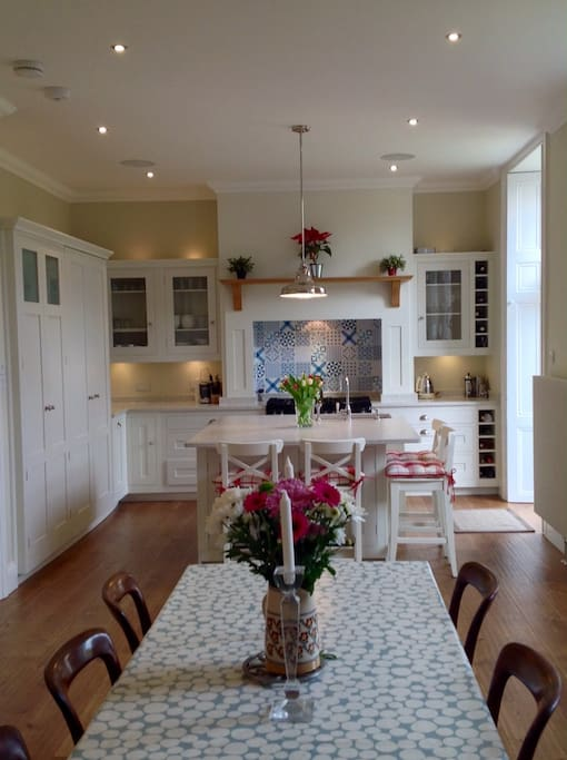 Kitchen island seats 4 - 6, and dining table seat 6 - 12 people.