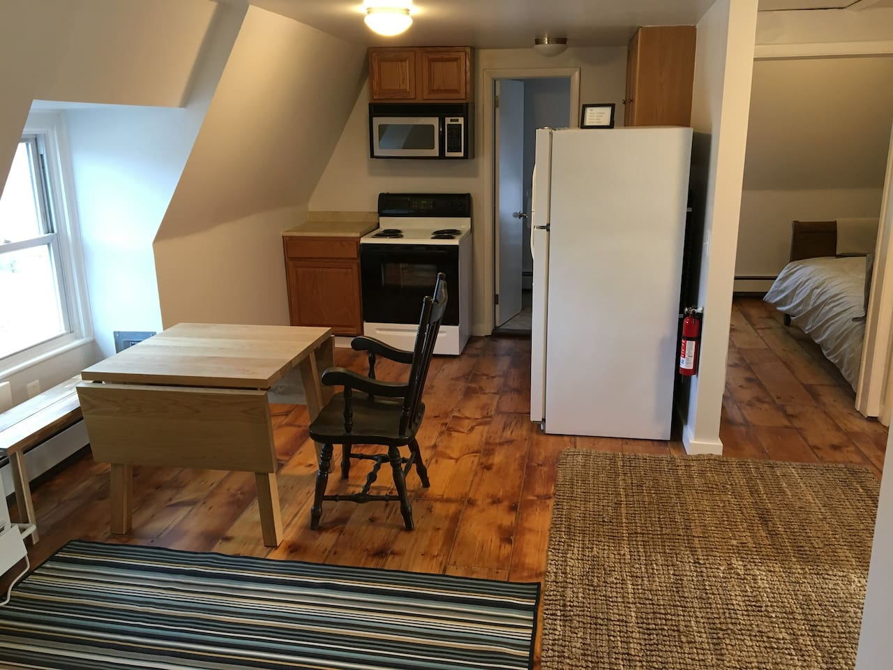 Newly renovated kitchen and partial view of bedroom #2