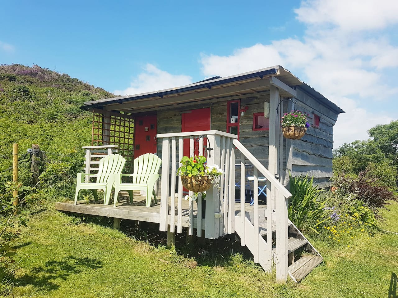 The self-contained cabin is set in our garden  with lovely  countryside views.