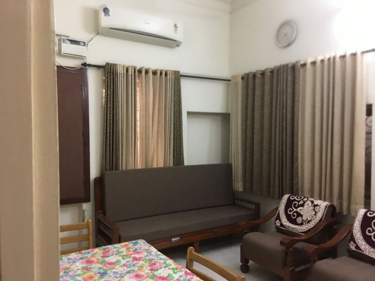 Welcome hall 14 x 12.  with 2 piece sofa ,Dining Tablle and a Foldable sofa cum bed  . Split AC 1.5 T