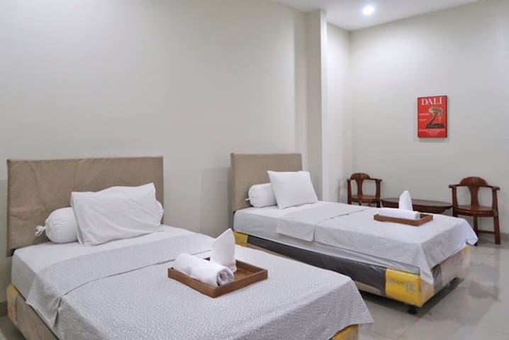 1st fl bedroom, 2 fullsize bed. 26m2 (280 sqft) + private patio.