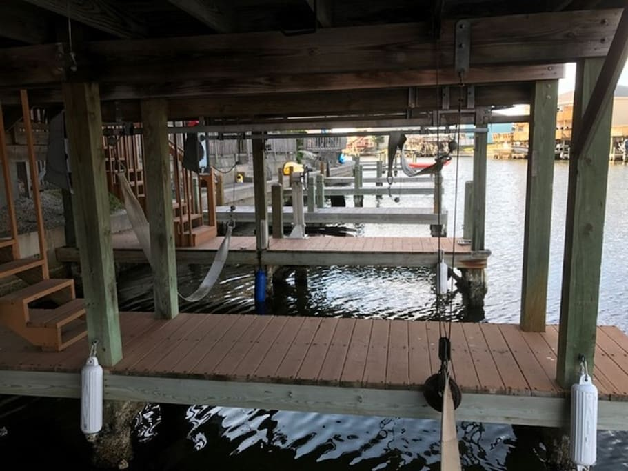 Private Covered Boat Slip with motorized lift, water hose and electrical outlets
