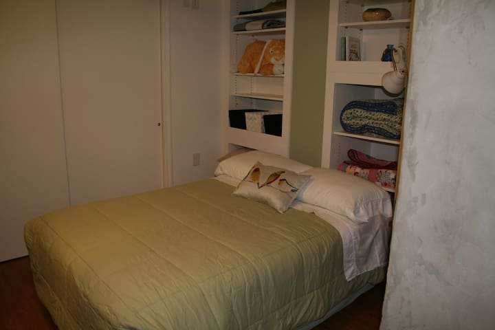 walking space on either side of full size bed in private bedroom