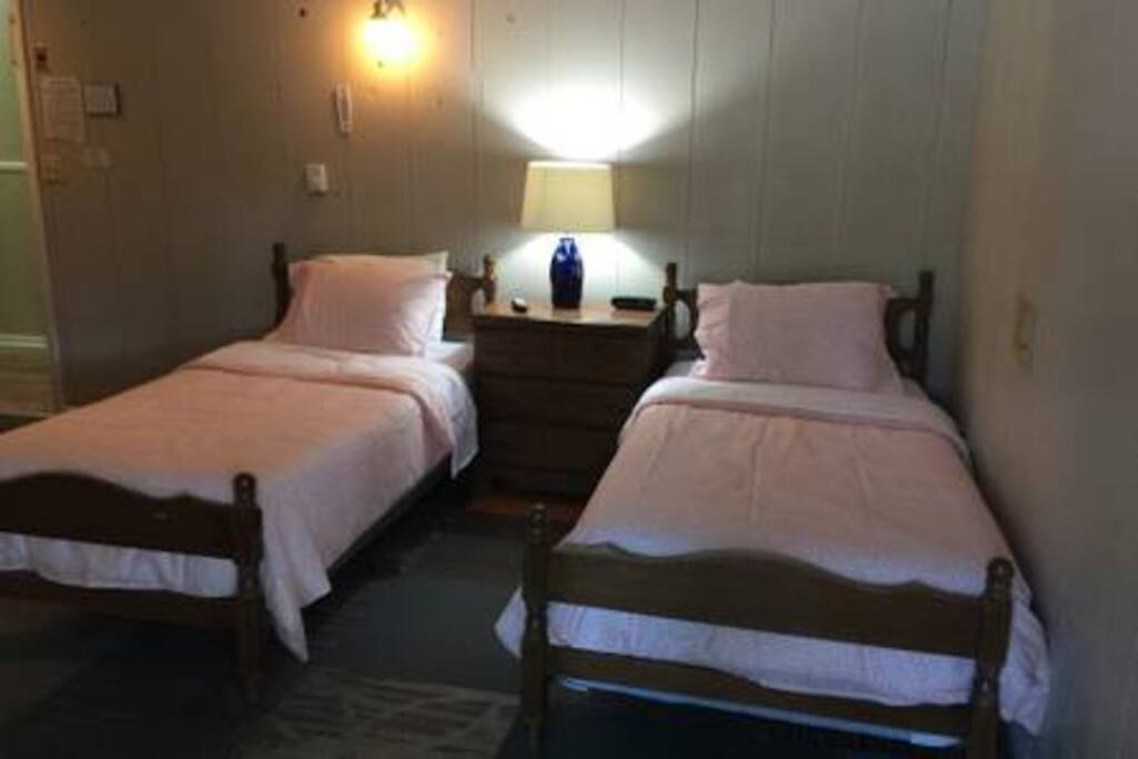 Room with two twin beds.