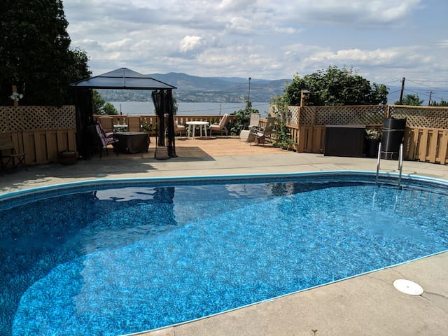 View of the pool and lake Okanagan from the suite door.