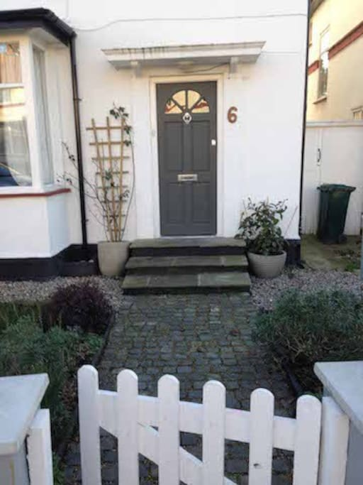 Front door with classic English cobbled pathway