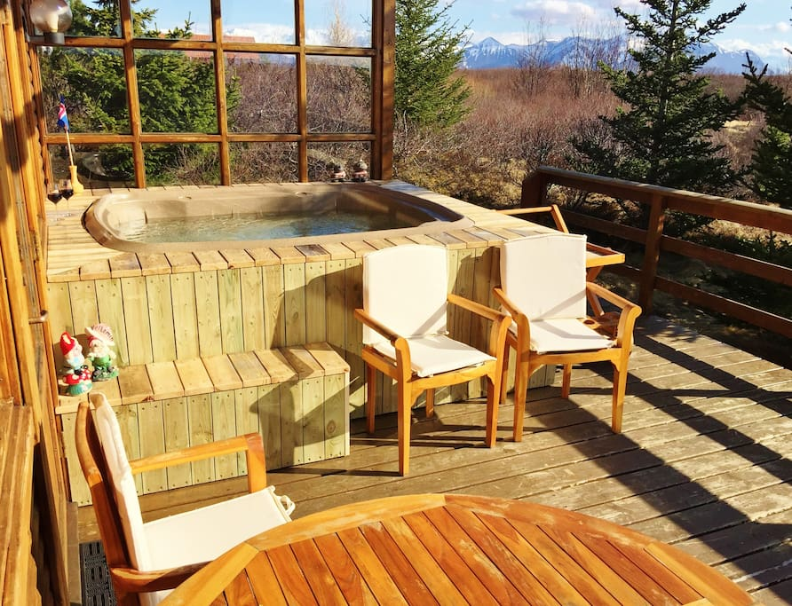 The Hot Tub on the porch with a mountain view to the South and North.