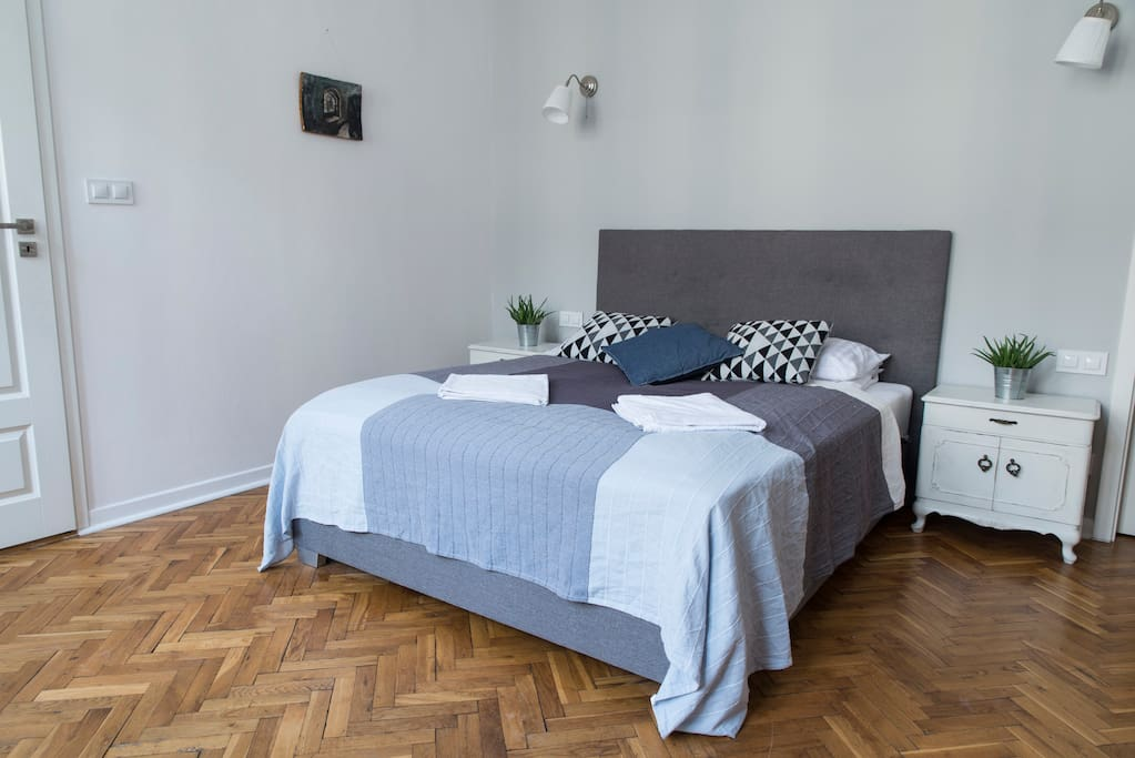 BEDROOM consists not only of comfortable QUEEN-SIZE BED (160x200). It is equipped with 2 identical wooden cupboards, nice chair, stand with hangers and a working station (designers wooden desk with lamp)
