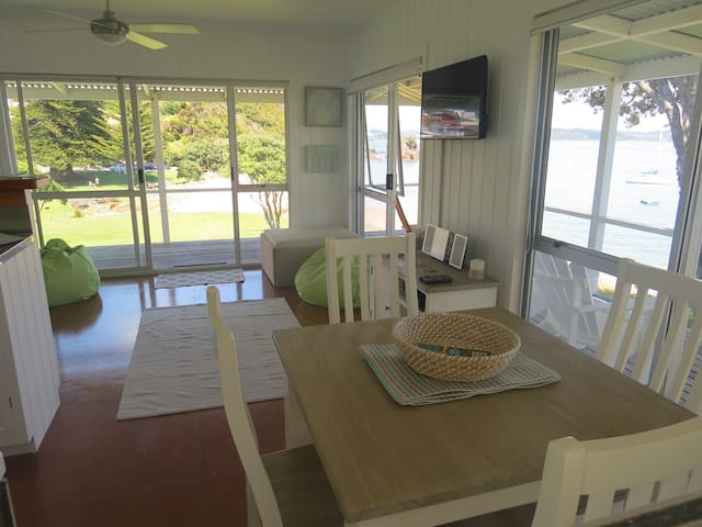 Open plan air conditioned living and dining with TV, DVD and Bluetooth sound system