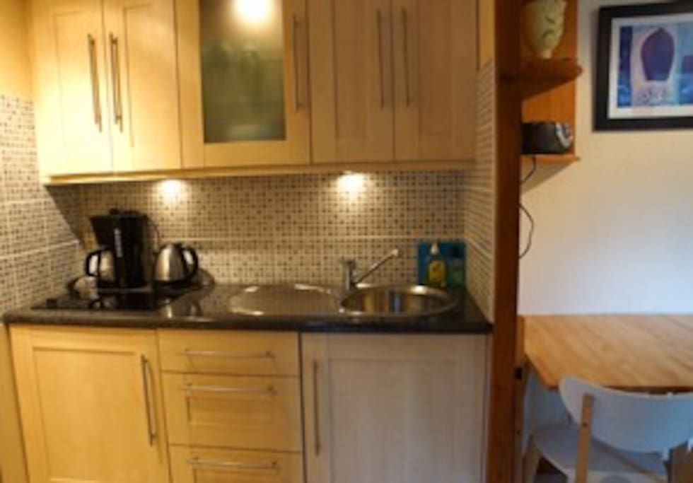 Kitchen area with hob.