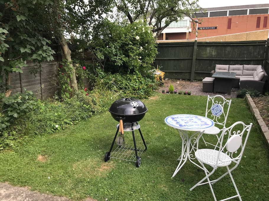 Large private garden with seven seater furniture set, BBQ and two seater bistro table