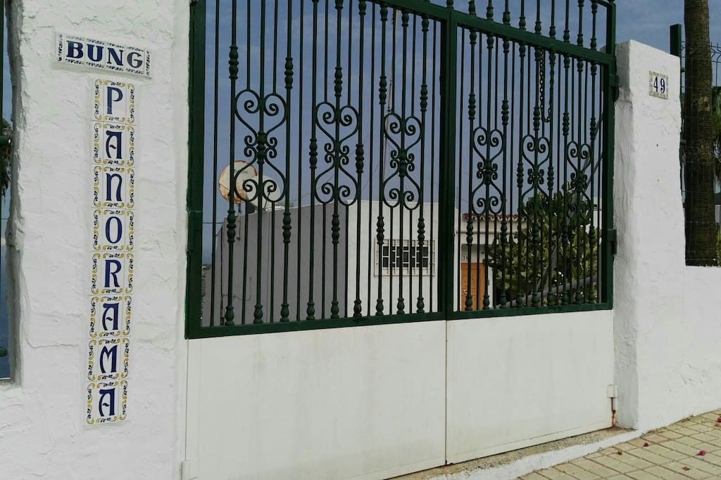 Upper gate( PUERTA DE ARRIBA) Avda. Los Guaires,  49. This is the nearest gate to our apartment.