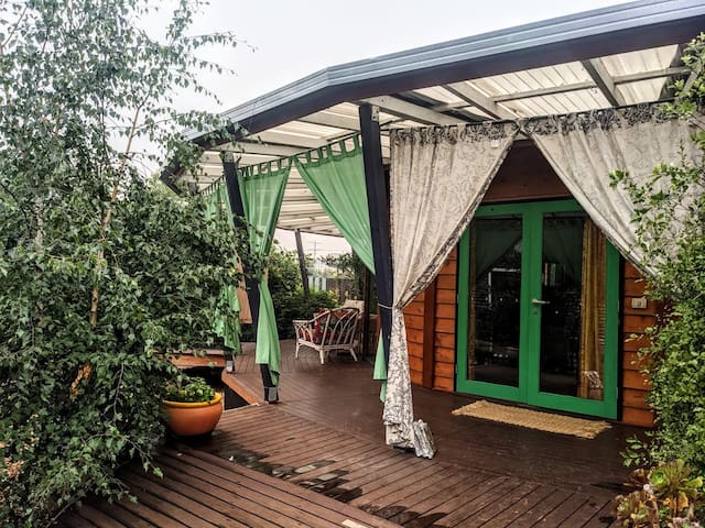 Curtains have been added for summer and can enclose the verandah to make it even more private and shady.