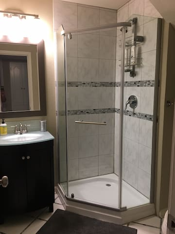 Private bathroom is adjacent to the guest room. Soap, shampoo, and a blow dryer are provided.