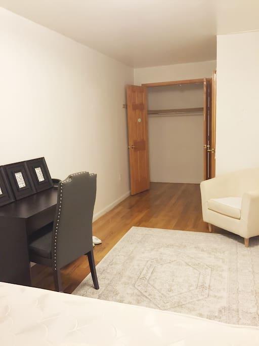 Bed room: computer desk, sofa and closet