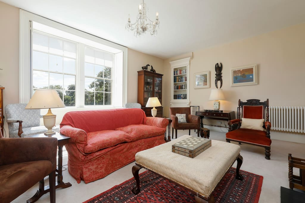 The drawing room is a formal but cosy room to relax in - gather around a log fire and watch TV with the family, or play a board game on the ottoman.