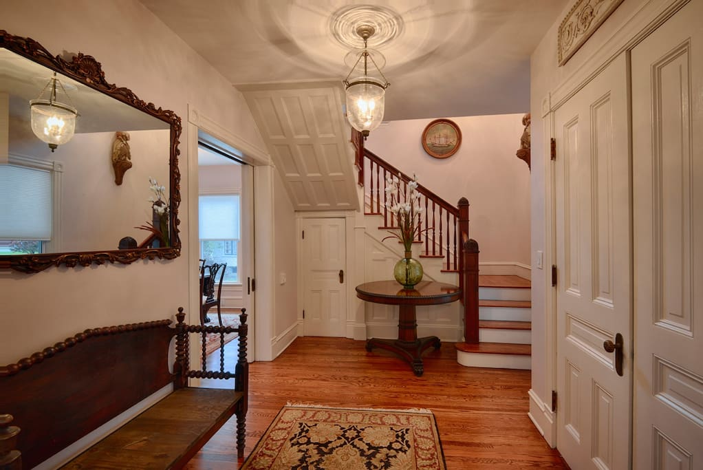 First Floor Entry Foyer with Seating and Stairs Leading to the 2nd Floor