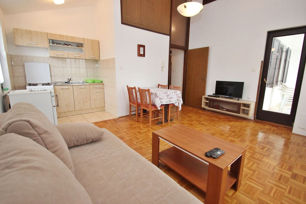 Spacious living room with dinning area and kitchen.