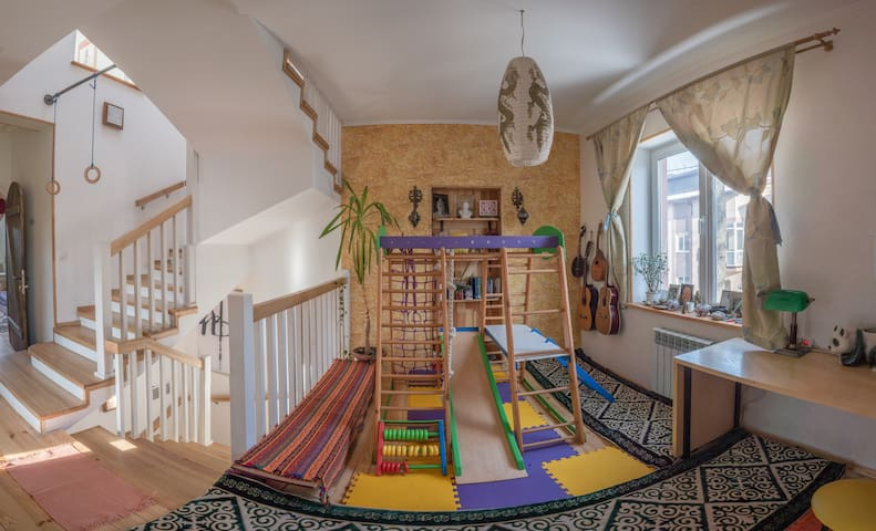 wide common space and play zone, carpets and wooden floor on the 2nd floor